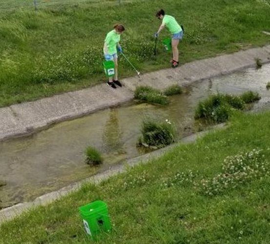 Volunteers cleaning out drainage channel