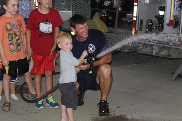 Fire truck water hose fun at Block Party