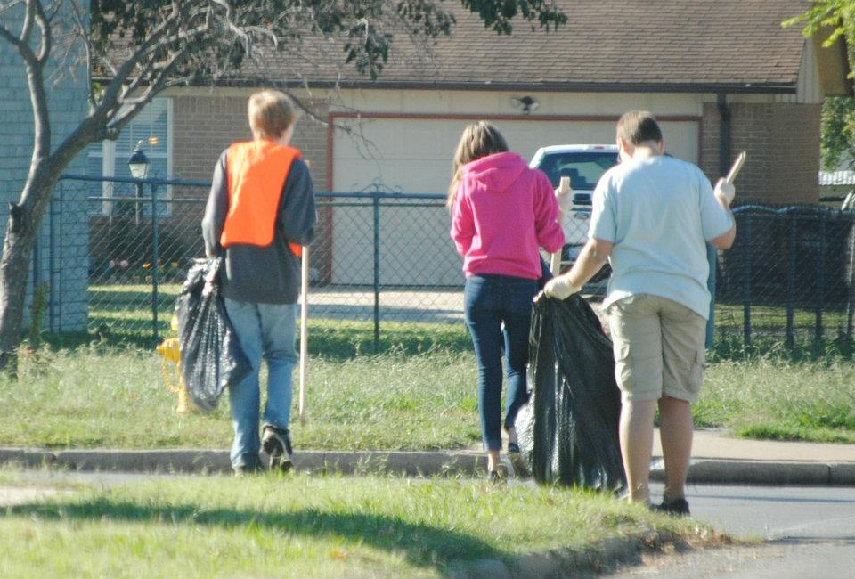 Volunteers picking up trash along nhood street-2